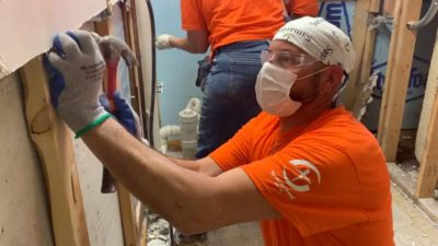 After pulling out walls and flooring, volunteers also make homes ready for repairs.