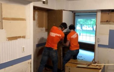 Volunteers in Midland removed ruined floors, walls, and cabinets from flooded homes.