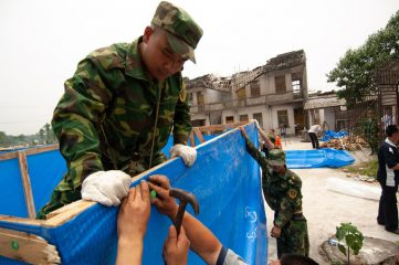 Local residents and Chinese military constructed emergency shelter with plastic sheeting provided by Samaritan's Purse.