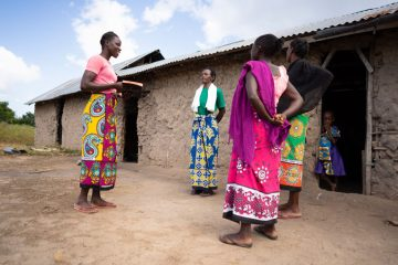 Karembo shares the Gospel with others in her village.
