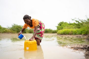 The nearby water pond now saves Eunice many hours of traveling to get water.