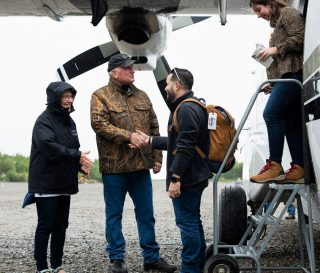 Franklin and Jane Austin Graham greet Brad and Jesy Martinez as they arrive at Samaritan Lodge Alaska—beginning the first week of the Operation Heal Our Patriots 2020 summer season.
