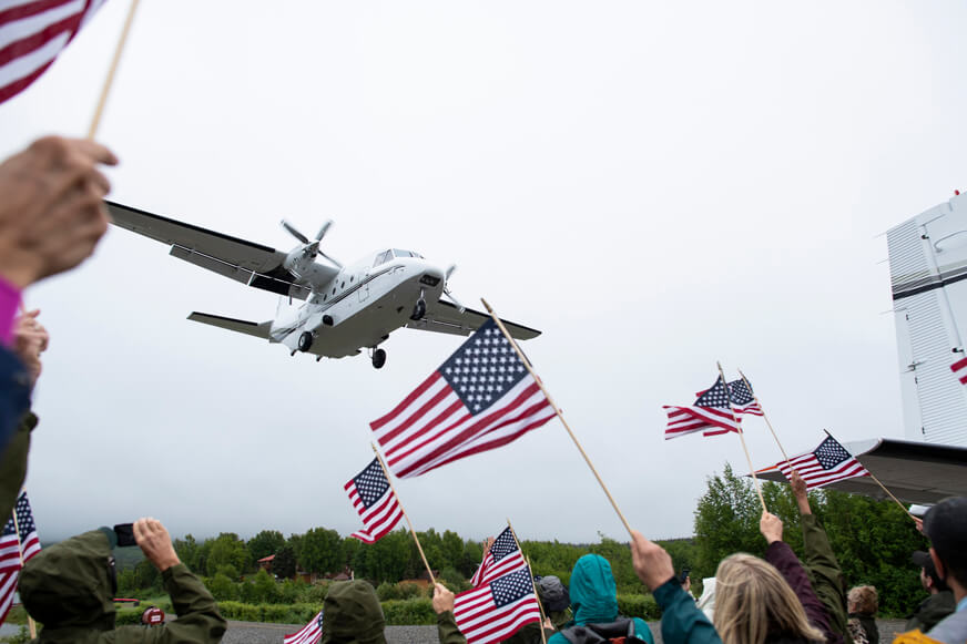 Dozens of staff, volunteers, and townspeople came to the Port Alsworth runway to welcome the first two planeloads this year of injured military personnel and their spouses to Samaritan Lodge Alaska.