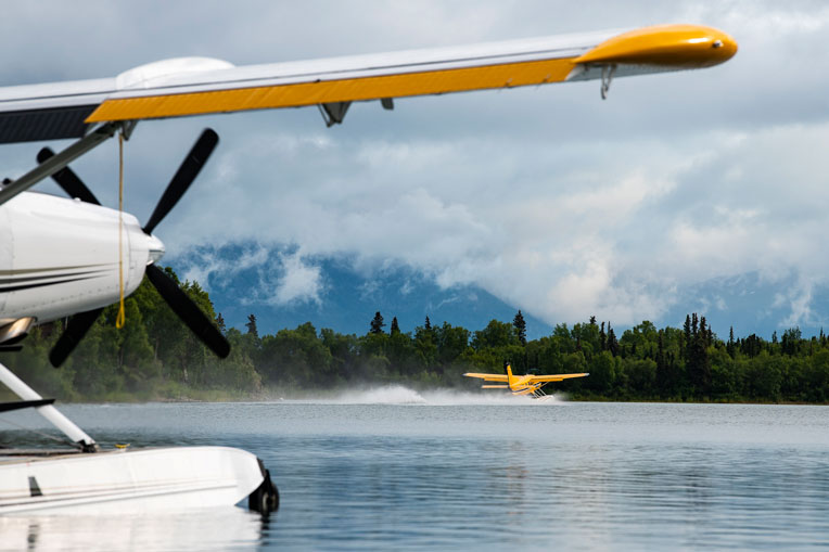 A Samaritan's Purse floatplane nears take off into the majestic Alaska wilderness.