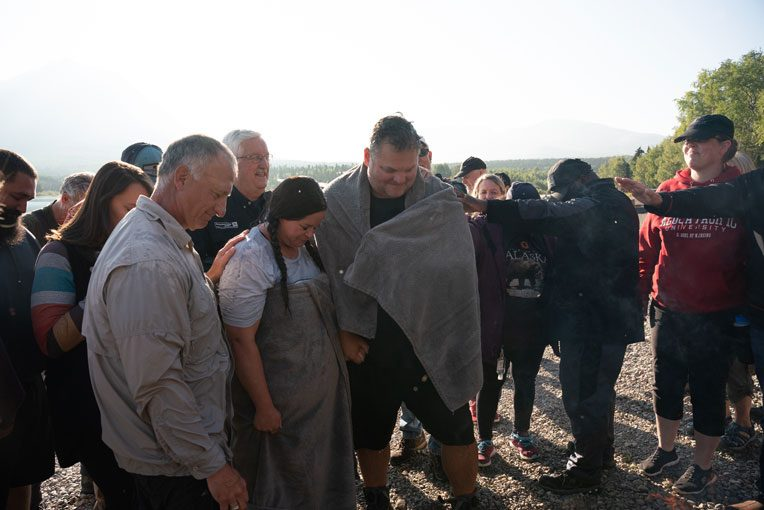 Our chaplains and military couples join together to pray over Josh and Kyli after their baptism.