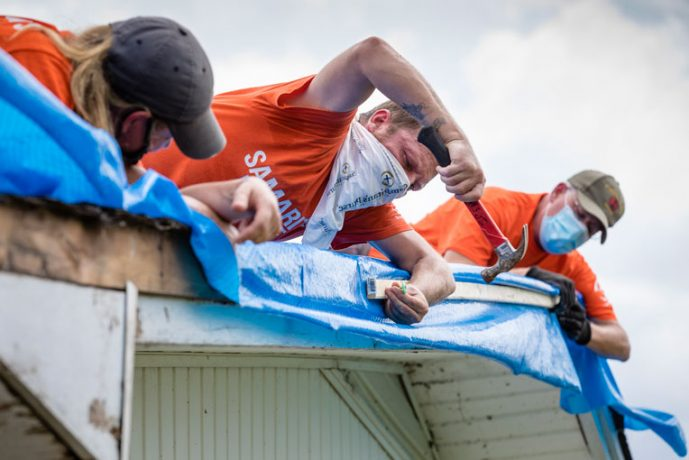 Our teams are working hard to assist homeowners by tarping damaged roofs.