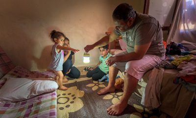 Rahim brings light to the room where his children sleep. Hope, like light, has once again brightened their home in Beirut.