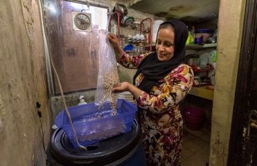 Nazia prepares a meal for her family.