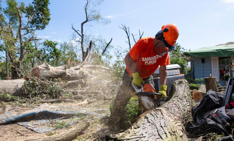 Volunteers are at work in Cedar Rapids and in Tama County Iowa where a powerful storm system devastated neighborhoods with powerful winds.