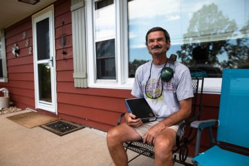 Homeowner Jeff Wise was overwhelmed with gratitude and emotion at the site of so many volunteers at his house. And he was grateful and excited to read his new Bible provided by the team.