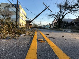 The devastating impact of Hurricane Laura is marked by debris, downed trees and power lines, and silence in Lake Charles.