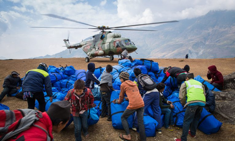 Nepalese military helicopters airlifted supplies high into the remote mountain villages.