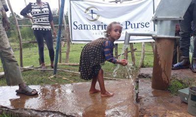 Children in rural Ethiopia enjoy water from a well restored by Samaritan's Purse.