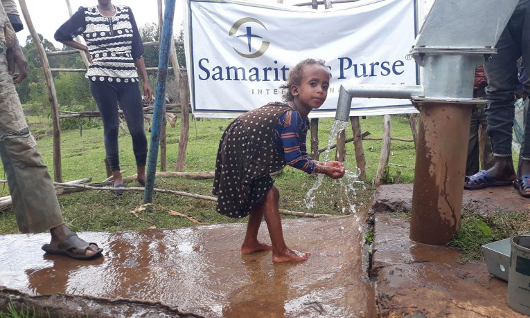 Children in rural Ethiopia enjoy water from a well restored by Samaritan's Purse.