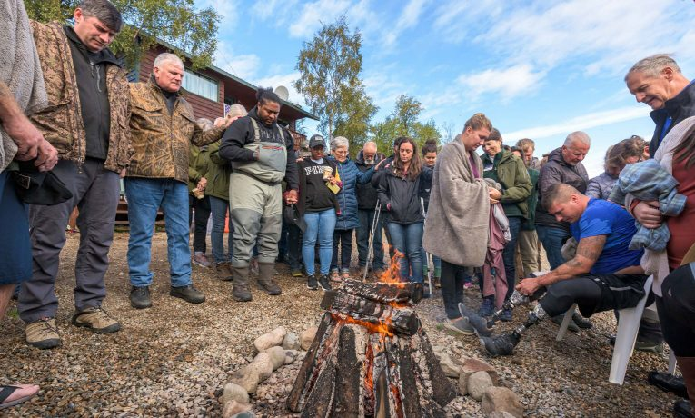Chaplains, staff, and volunteers gathered with Franklin Graham and his son Will to pray for the many individuals who were baptized in the glacier-fed waters of Lake Clark.