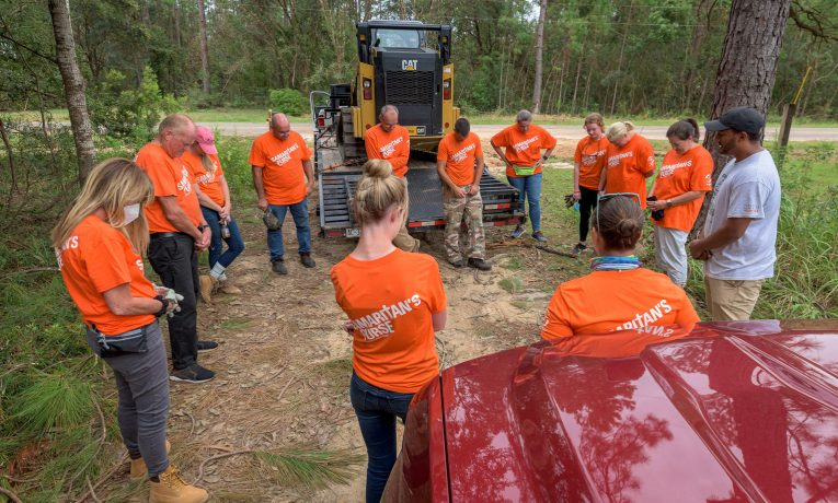 Volunteers are working in Baldwin County, Alabama, where Hurricane Sally flooded homes with torrential rain.
