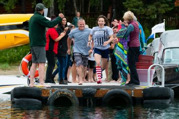 Southern do the polar plunge into chilly Lake Clark