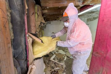 Volunteers ripped out damaged insulation in Bud's home.