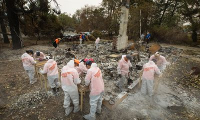 Volunteers are sifting through the ashes of homes burned by wildfires in Jackson County, Oregon.
