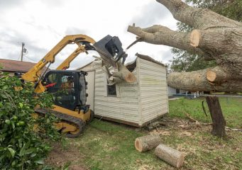 Removing tree limbs that fell on a shed in the Ramey's backyard.