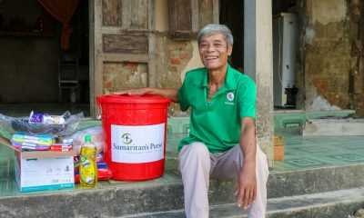 Hop, a beneficiary in Vietnam receives, relief supplies from Samaritan's Purse.