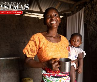 Eunice with water filter in Kenya