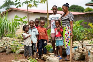 Mary Campbell has found it difficult to feed her children, but through the crops she's harvest now her family can eat with enough left over to sell.