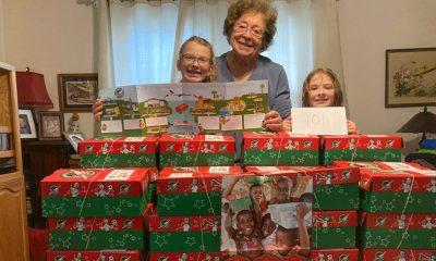 Lula Singletary celebrates completing her first 101 shoeboxes of the season together with great-grandchildren Lily (left) and Iris (right).