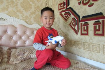 Erdene received a toy airplane for his sixth birthday. He's been fascinated by airplanes, especially after riding in our DC-8 cargo jet back home to Mongolia.