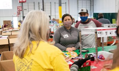 Army Sergeant Chris and Nicol Weis process Operation Christmas Child shoebox gifts in Dallas, Texas.