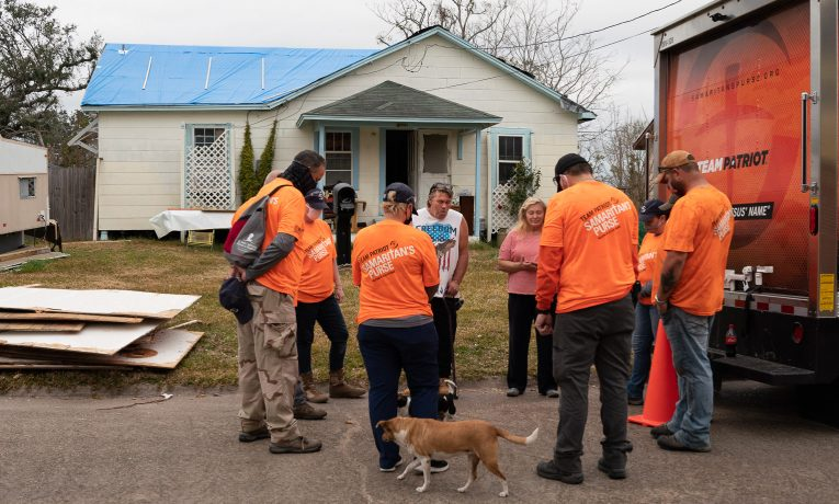 Volunteers start and end their work day in prayer with the homeowners.