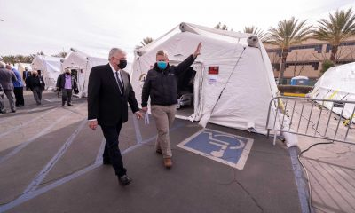 Franklin Graham tours the Emergency Field Hospital in Los Angeles County alongside Dr. Elliott Tenpenny, director of the Samaritan's Purse International Health Unit.