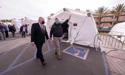 Franklin Graham tours the Emergency Field Hospital in Los Angeles County alongside Dr. Elliott Tenpenny, director of the Samaritan's Purse International Health Unit.