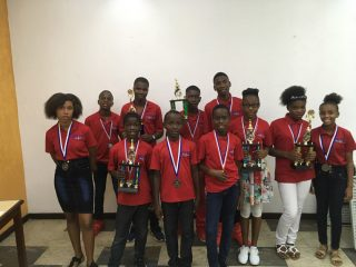 Members of our Greta Home and Academy chess club enjoy the challenge and thrill of competition. But even more than that, they've blossomed because of the confidence it has given them. Lovemaillie and Angelo,  back row, second and third from left, are preparing to play at the highest levels of the game.