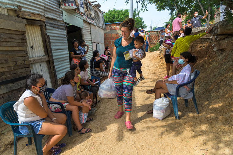 Brithany, Alexandra's daughter, walks home after receiving a food basket for her family from Samaritan's Purse.