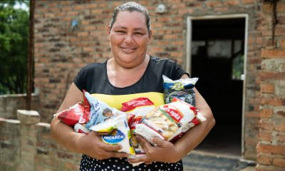 Alexandra with some of the food items she received in her basket from Samaritan's Purse.
