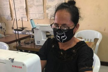 Florencia is helping support her family by making and selling facemasks.