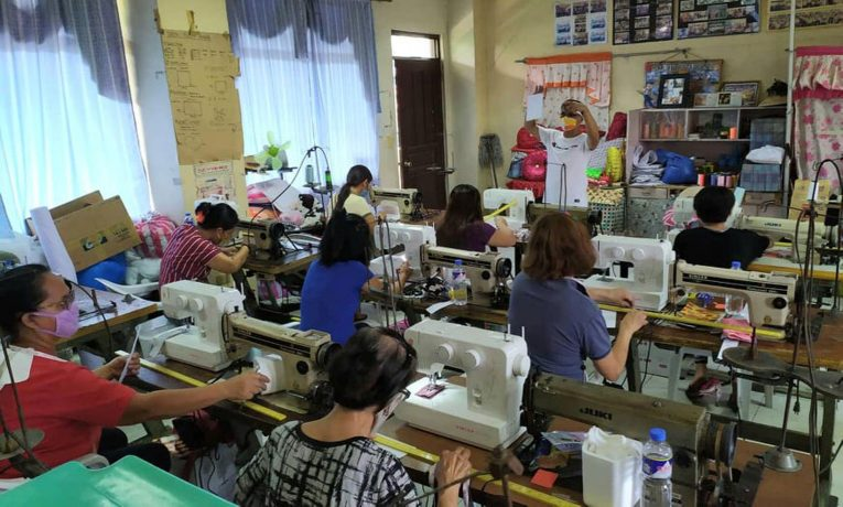 Women in the Philippines learn how to sew facemasks.