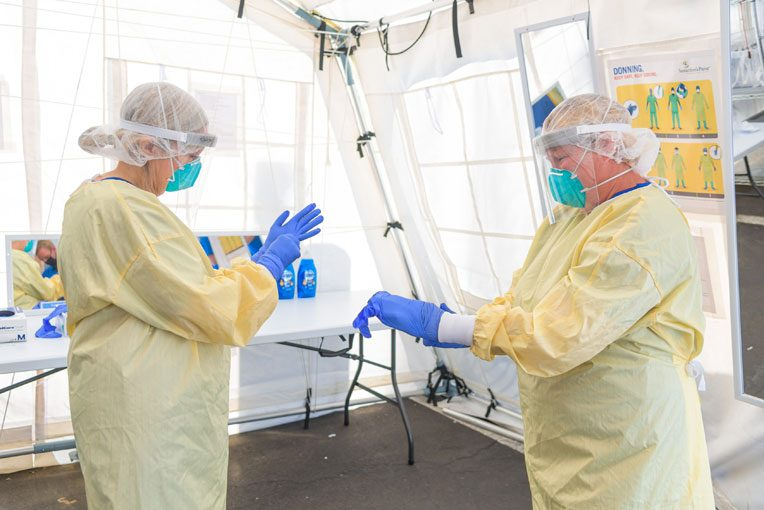 Medical staff always donned personal protective equipment before entering the facility to care for patients.