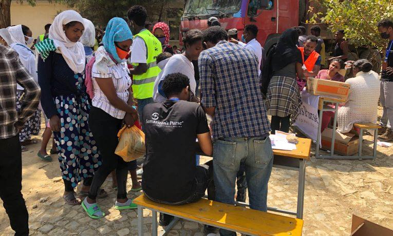 Samaritan's Purse distributes supplemental nutrition to parents of children in need.