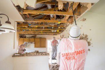 Volunteers work on Netsi's Texas home.