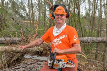 Volunteer Chris Bailey drove nearly 900 miles from Texas to serve in Alabama. His own tornado experience at age 9 has compelled him to help other storm victims.