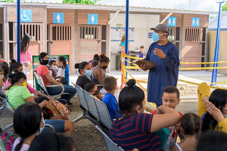 Chaplain Eduard Vargas speaks as the clinic opens one morning in Puerto Santander.