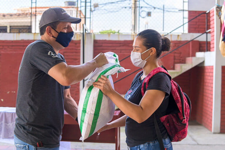 Blanca, a mother of three, receives food for her family from Samaritan's Purse.