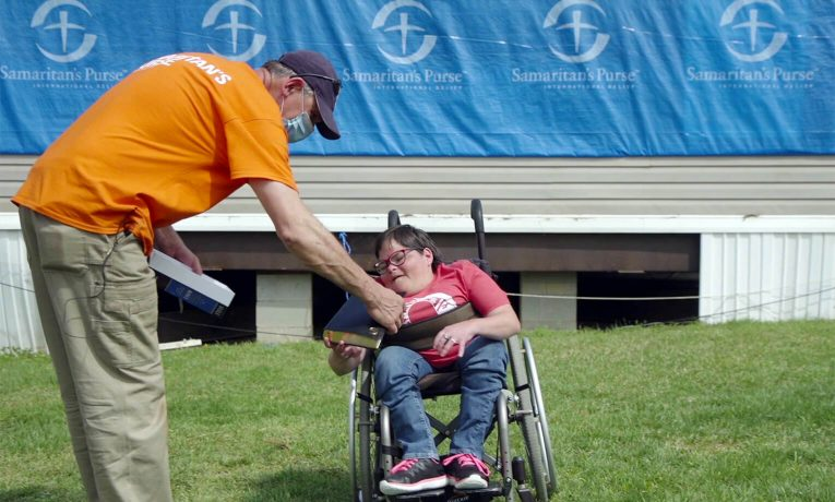 Samaritan's Purse volunteers working in tornado-damaged Etowah County, Alabama, presented a special study Bible to a wheelchair-bound homeowner.