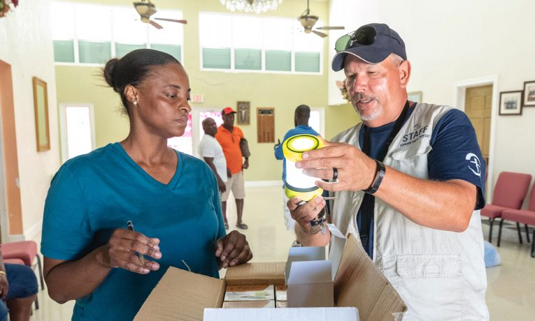 Bryan Babcock helps distribute solar lights to victims of Hurricane Dorian.