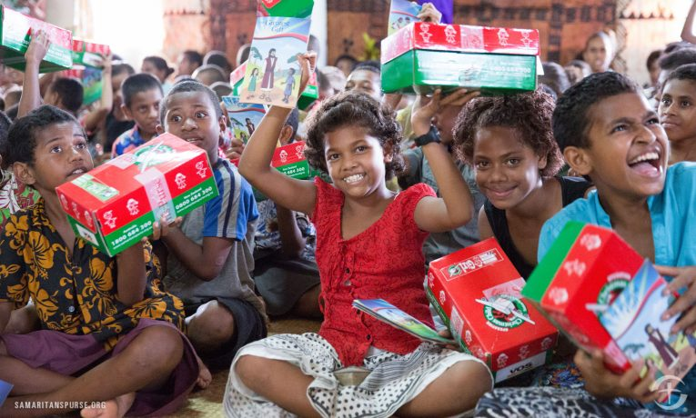 Children are delighted to receive Operation Christmas Child shoebox gifts during a previous distribution event in the Pacific Islands.