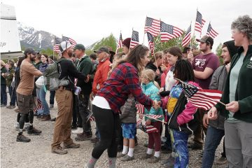 Military couples are greeted warmly with flags waving upon arrival at Samaritan Lodge Alaska.