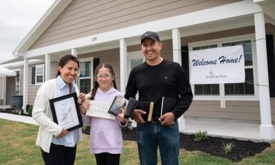 Leticia Jaimes, her daughter Daniela, and Leticia's brother David celebrate the new home in LaGrange, Texas.