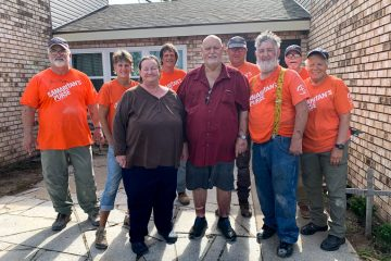 Homeowners Mel and Sharon Williams with a team of our volunteers.